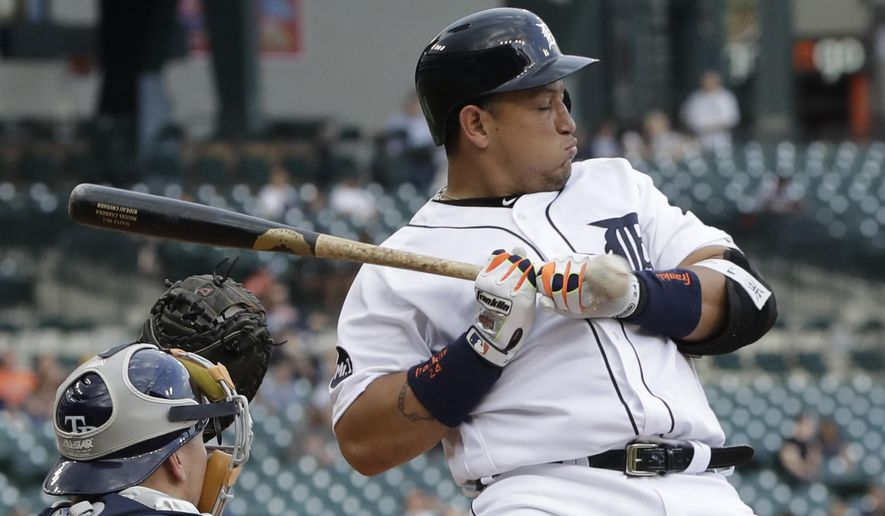 Detroit Tigers' Miguel Cabrera takes an inside pitch during the first inning of the team's baseball game against the Tampa Bay Rays, Thursday, June 15, 2017, in Detroit. (AP Photo/Carlos Osorio)