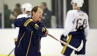 FILE - In this Sept. 18, 2015, file photo, Nashville Predators assistant coach Phil Housley instructs players at NHL hockey training camp in Nashville, Tenn. The Buffalo Sabres hire Housley as their new coach, the club announced Thursday, June 15, 2017. (AP Photo/Mark Humphrey, File)