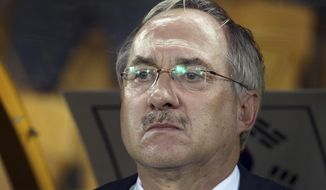 FILE - This Jan. 17, 2015, file photo sows South Korea's soccer coach Uli Stielike ahead of an AFC Asia Cup soccer match between Australia and South Korea in Brisbane, Australia. Stielike was fired as South Korea's head coach after poor results in World Cup qualifying. South Korea's football association made the announcement Thursday, June 15, 2017, two days after a 3-2 loss in Qatar. It was South Korea's third defeat in the last five qualification games and left hopes of progressing to a ninth successive World Cup uncertain. (AP Photo/Tertius Pickard, File)