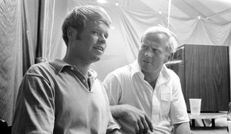 In this June 1971 file photo, Jim Simons left, and Jack Nicklaus get together after they took the lead in the U.S. Open golf tournament at the end of three rounds of play at Merion in Ardmore, Pa. Simons was a threat to the end at Merion. He was one shot behind going to the 18th hole until making a double bogey to finish three shots out of a playoff that Lee Trevino won the following day over Nicklaus. No amateur has won the tournament since 1933. (AP Photo)