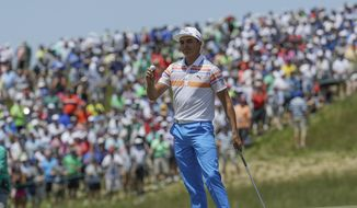 Rickie Fowler acknowledges the crowd after his first round of the U.S. Open golf tournament Thursday, June 15, 2017, at Erin Hills in Erin, Wis. (AP Photo/David J. Phillip)