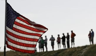 Fans stand near the 10th hole during the first round of the U.S. Open golf tournament Thursday, June 15, 2017, at Erin Hills in Erin, Wis. (AP Photo/David J. Phillip)