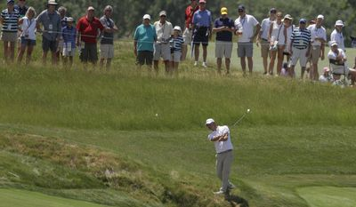 Lucas Glover hits from the rough on 18 during the first round of the U.S. Open golf tournament Thursday, June 15, 2017, at Erin Hills in Erin, Wis. (AP Photo/Chris Carlson)