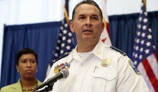 Metropolitan Police Department Chief Peter Newsham, right, accompanied by District of Columbia Mayor Muriel Bowser, speaks during a news conference in Washington, Thursday, June 15, 2017, about the May 16, 2017, altercation outside the Turkish Embassy in Washington during the visit of the Turkish president. Police say they've issued arrest warrants for a dozen Turkish security agents and two others accused of taking part in a violent altercation May 16 as Turkey's president visited Washington.  (AP Photo/Alex Brandon)