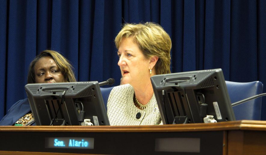 Sen. Sharon Hewitt, R-Slidell, right, speaks about the state operating budget proposal while Sen. Regina Barrow, D-Baton Rouge, listens on Thursday, June 15, 2017, in Baton Rouge, La. (AP Photo/Melinda Deslatte)