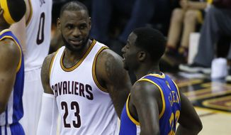 Cleveland Cavaliers forward LeBron James (23) and Golden State Warriors forward Draymond Green (23) talk during the first half of Game 3 of basketball's NBA Finals in Cleveland, Wednesday, June 7, 2017. (AP Photo/Ron Schwane)