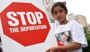 Khloe Marogi, 8, wore a T-shirt with her detained father's photo on it at a rally on Friday in Detroit to protest the recent Immigration and Customs Enforcement raids in which 114 Iraqi nationals in Metro Detroit were arrested and held for deportation. Her father, 50-year-old Dorid Marogi, is a Catholic Chaldean who has lived in the U.S. since he was 2 years old. (Associated Press)