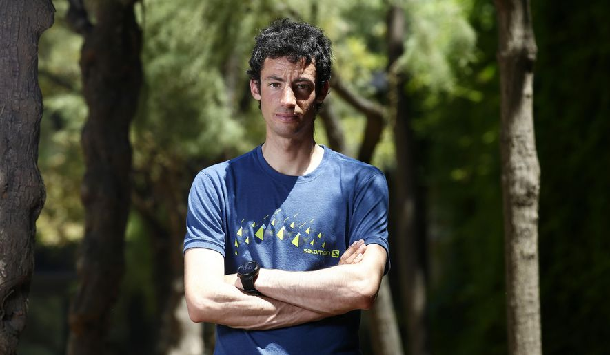 In this photo taken Monday, June 12, 2017, Kilian Jornet from Spain poses for a photograph after an interview with The Associated Press in Barcelona, Spain. Even the hardiest few who scale the treacherous slopes of Mount Everest cut short celebrations for some well-deserved rest. Not Kilian Jornet. He somehow still had enough legs left to scale the mountain again a few days later. (AP Photo/Manu Fernandez)