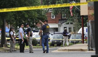 FBI agents investigate the scene at the YMCA in Alexandria, Va., Thursday, June 15, 2017, the day after House Majority Whip Steve Scalise of La. was shot during during a congressional baseball practice nearby. (AP Photo/Jacquelyn Martin)