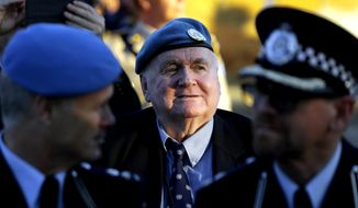 Ian Hardy, 79, the first Australian U.N police officers in the island 53 years ago, is seen during a flag-lowering ceremony to ended Australia's peacekeeping contribution in Cyprus, inside the U.N buffer zone in divided capital Nicosia, Friday, June 16, 2017. After 53 years of helping to keep the peace on ethnically divided Cyprus, Australia is calling it quits and pulling out its last three police officers serving with a United Nations peacekeeping force. (AP Photo/Petros Karadjias)