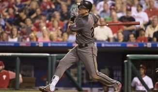 Arizona Diamondbacks' Jake Lamb hits a sacrifice fly to score David Peralta during the seventh inning of a baseball game against the Philadelphia Phillies, Friday, June 16, 2017, in Philadelphia. (AP Photo/Chris Szagola)