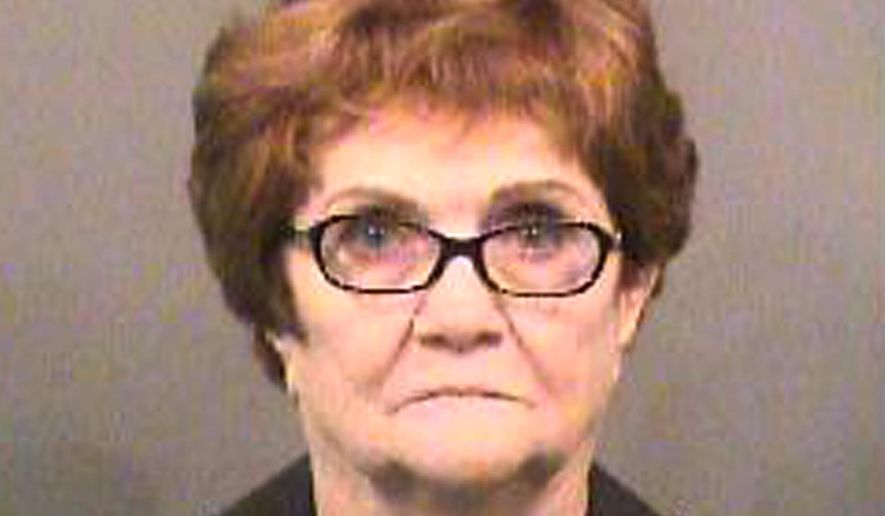 FILE - This booking file photo released by Sedgwick County Sheriff's Office shows Lila Mae Bryan of Mesquite, Texas. The 82-year-old Texas woman was arrested and jailed for about two hours after she scuffled with a Kansas airport security officer who confiscated an oversized liquid from her carry-on bag, early Wednesday, May 31, 2017, authorities said. Wichita City Attorney Jennifer Magana said the case against Bryan was dismissed Friday, June 16 at the request of the security agent and she will not face charges. (Sedgwick County Sheriff's Office via AP File)