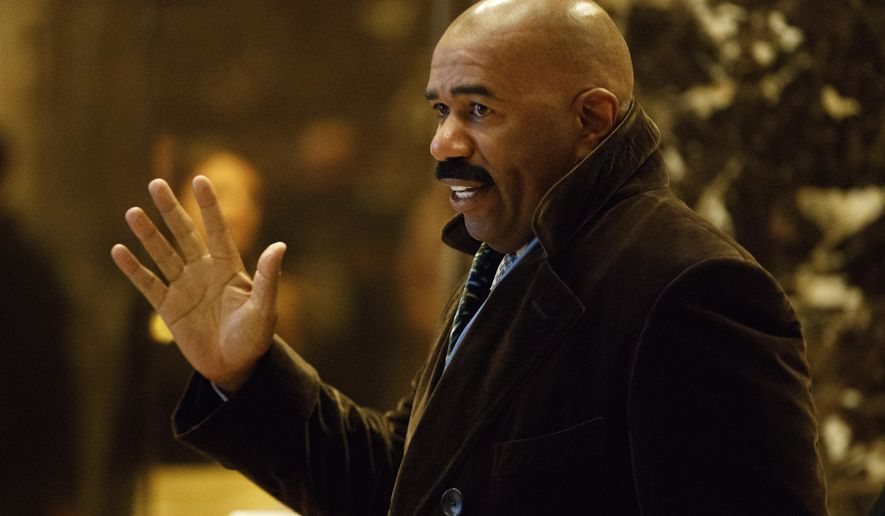 """FILE - In this Jan. 13, 2017 file photo, Comedian Steve Harvey arrives in the lobby of Trump Tower in New York to meet with President-elect Donald Trump. Apologies are being demanded from Harvey following comments about Flint's lead-tainted water crisis. Flint resident Dee Smith says Harvey told him to """"enjoy your brown cup of water"""" during a Wednesday June 14, 2017 call-in to Harvey's radio show. (AP Photo/Evan Vucci)"""