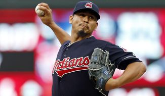 Cleveland Indians pitcher Carlos Carrasco throws against the Minnesota Twins in the first inning of a baseball game Friday, June 16, 2017, in Minneapolis. (AP Photo/Jim Mone)