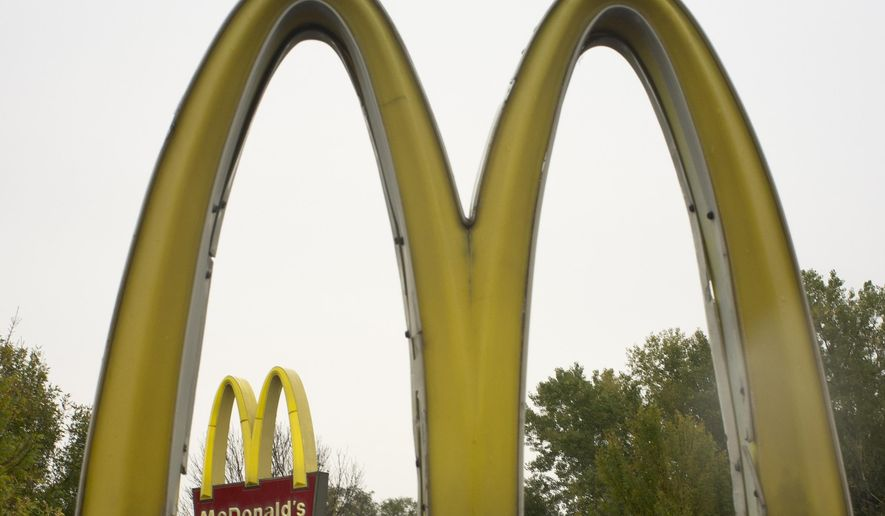 FILE - This Oct. 21, 2011 file photo shows the golden arches of McDonalds, in Omaha, Neb.,  McDonald's has ended its Olympic sponsorship deal three years early. The International Olympic Committee says confidential financial terms of the immediate separation were agreed to.(AP Photo/Nati Harnik)