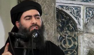 This file image made from video posted on a militant website Saturday, July 5, 2014, purports to show the leader of the Islamic State group, Abu Bakr al-Baghdadi, delivering a sermon at a mosque in Iraq during his first public appearance. The Russian military claims it has killed the leader of the Islamic State group in an airstrike. The ministry said Friday, June 16, 2017, that Abu Bakr al-Baghdadi was killed in a Russian strike in late May along with other senior group commanders. (AP Photo/Militant video, File)