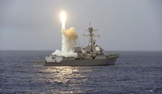 In this March 7, 2017, the guided-missile destroyer USS Fitzgerald (DDG 62) launches a missile from the aft missile deck during Multisail 17, a training exercise designed to improve interoperability between the U.S. and Japanese forces, in the Philippine Sea. The U.S. Navy destroyer has collided with a merchant ship off the coast of Japan, the U.S. military said, and there have been injuries. In a brief written statement, the U.S. Pacific Fleet in Hawaii said the Navy has requested assistance from the Japanese Coast Guard. (Mass Communication Specialist 2nd Class William McCann/U.S. Navy via AP)