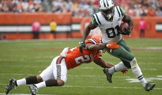 FILE- In this Oct. 30, 2016, file photo, New York Jets wide receiver Quincy Enunwa (81) breaks a tackle by Cleveland Browns strong safety Ibraheim Campbell, left, on a touchdown run in the second half of an NFL football game in Cleveland. The main offseason storyline is focused on who will win the starting quarterback job, but once they figure that out who will they be throwing to? Enunwa is the most experienced of the bunch, with 80 catches for 1,172 yards and four TDs in three seasons over 29 games. (AP Photo/Ron Schwane, File)