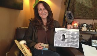 In this June 12, 2017, photo, Betsy Roddy of Los Angeles holds a copy of the Aug. 17, 1910, edition of The River Press of Fort Benton, Mont. The newspaper was one of the first to report on Father's Day, an event held for the first time in June of that year in Spokane, Wash., after Roddy's great-grandmother, Sonora Smart Dodd, lobbied local church and public officials for its creation. In the years that followed, Father's Day grew to become an international event and Dodd lived to see President Richard Nixon declare it an official U.S. holiday in 1972. (AP Photo/John Rogers)