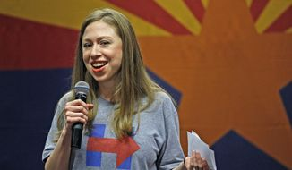 In this Oct. 19, 2016, file photo, Chelsea Clinton laughs as she talks to a crowd at Arizona State University about her years in the White House as a kid while campaigning for her mother, Democratic presidential candidate Hillary Clinton, in Tempe, Ariz. (AP Photo/Ross D. Franklin, File)