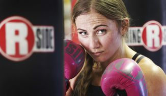 In this Wednesday, June 7, 2017 photo, boxer Whitney Gomez poses before a workout at Fullmer Brothers Boxing gym in South Jordan, Utah. Gomez said her dream of competing in the Olympics was born long before she ever stepped into a boxing ring. (Scott G Winterton/The Deseret News via AP)
