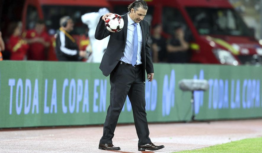 Chile's coach Juan Antonio Pizzi, catches the ball during the international friendly soccer match between Romania and Chile at the Cluj Arena stadium in Cluj, Romania, Tuesday, June 13, 2017. (AP Photo/Mihaela Bobar)