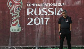 Portugal coach Fernando Santos walks on the pitch a training session at the Rubin Training Ground in Kazan, Russia, on Friday, June 16, 2017. Portugal will play Mexico in the Confederations Cup, Group A soccer match scheduled for Sunday, June 18, 2017. (AP Photo/Sergei Grits)