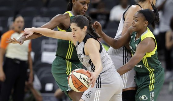 FILE - In this June 6, 2017, file photo, San Antonio Stars guard Kelsey Plum drives with the ball during the second half of a WNBA basketball game against the Seattle Storm in San Antonio. Plum returns to her college hometown of Seattle this weekend when San Antonio faces Seattle on Sunday. It's a return to the city where Plum developed into the NCAA all-time record holder in scoring at Washington and it will be Plum's first trip back to Seattle since being drafted No. 1 overall by the Stars. (AP Photo/Eric Gay, File)