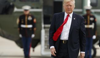 President Donald Trump walks from Marine One to board Air Force One for a trip to Miami to deliver a speech on Cuba policy, Friday, June 16, 2017, at Andrews Air Force Base, Md. (AP Photo/Evan Vucci)