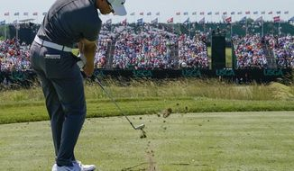 Cameron Champ hits from the ninth tee during the second round of the U.S. Open golf tournament Friday, June 16, 2017, at Erin Hills in Erin, Wis. (AP Photo/David J. Phillip)