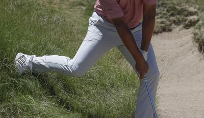 Si Woo Kim, of South Korea, hits from a bunker on the ninth hole during the second round of the U.S. Open golf tournament Friday, June 16, 2017, at Erin Hills in Erin, Wis. (AP Photo/Chris Carlson)