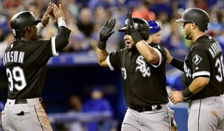 Chicago White Sox's Alen Hanson (39) and Omar Narvaez (38) congratulate Melky Cabrera (53) on a three-run home run during fifth-inning baseball game action against the Toronto Blue Jays in Toronto, Friday, June 16, 2017. (Frank Gunn/The Canadian Press via AP)