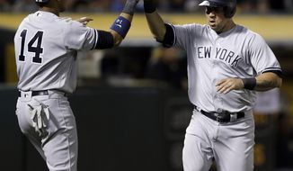 New York Yankees' Gary Sanchez, right, and Starlin Castro celebrate after scoring against the Oakland Athletics during the sixth inning of a baseball game Thursday, June 15, 2017, in Oakland, Calif. (AP Photo/Ben Margot)