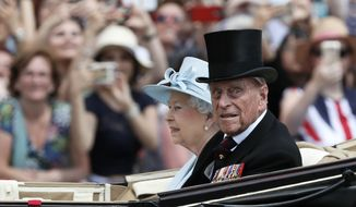 Britain's Queen Elizabeth II and Prince Philip, the Duke of Edinburgh return to Buckingham Palace in a carriage, after attending the annual Trooping the Colour Ceremony in London, Saturday, June 17, 2017. (AP Photo/Kirsty Wigglesworth) ** FILE **