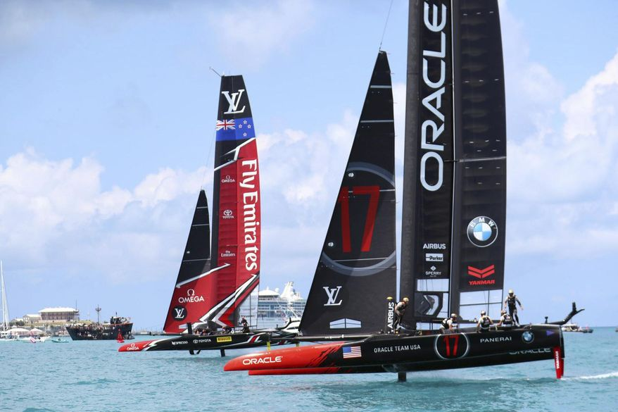 In this photo provided by the America's Cup Event Authority, shows Emirates Team New Zealand, left, competing against two-time defending champion Oracle Team USA, right,   Saturday, June 17, 2017, in the Great Sound of Bermuda, in Race 1 of the America's Cup.(Gilles Martin-Raget/ACEA via AP)