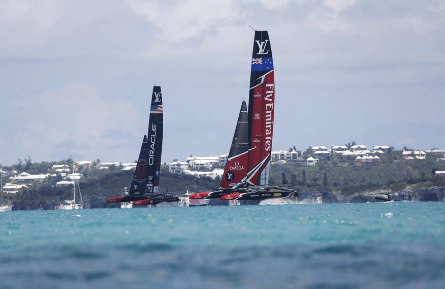 In this photo provided by the America's Cup Event Authority, shows Emirates Team New Zealand, right, competing against two-time defending champion Oracle Team USA, left,   Saturday, June 17, 2017, in the Great Sound of Bermuda, in Race 1 of the America's Cup.(Sander van der Borch/ACEA via AP)