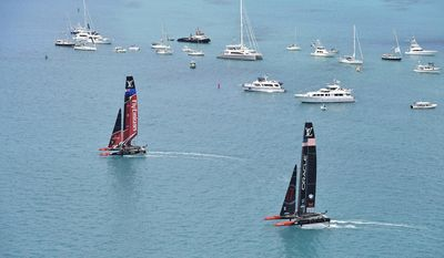 In this photo provided by the America's Cup Event Authority, shows Emirates Team New Zealand, left, competing against two-time defending champion Oracle Team USA, right,   Saturday, June 17, 2017, in the Great Sound of Bermuda, in Race 1 of the America's Cup.(Ricardo Pinto/ACEA via AP)