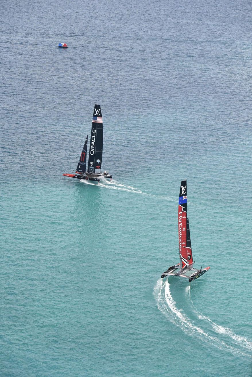 In this photo provided by the America's Cup Event Authority, shows Emirates Team New Zealand, right, competing against two-time defending champion Oracle Team USA, left,   Saturday, June 17, 2017, in the Great Sound of Bermuda, in Race 1 of the America's Cup.(Ricardo Pinto/ACEA via AP)