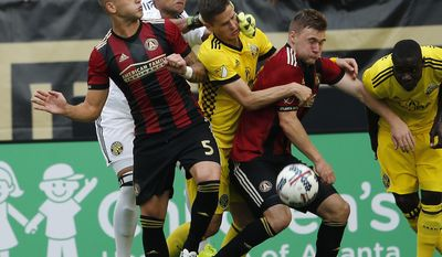 Atlanta United's Leandro Gonzalez (5) and Carlos Carmona (14) battle Columbus Crew defender Jukka Raitala (2) and Columbus Crew goalkeeper Zack Steffen (23) for the ball in the first half of an MLS soccer match, Saturday, June 17, 2017, in Atlanta (AP Photo/John Bazemore)