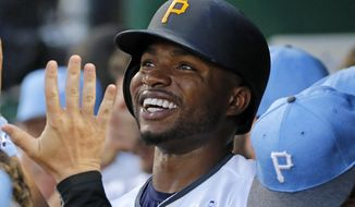 Pittsburgh Pirates' Gregory Polanco, center, celebrates with teammates in the dugout after hitting a two-run home run off Chicago Cubs starting pitcher Jake Arrieta in the first inning of a baseball game in Pittsburgh, Saturday, June 17, 2017. (AP Photo/Gene J. Puskar)