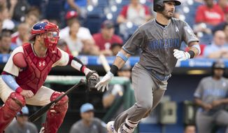 Arizona Diamondbacks' Daniel Descalso with the RBI single scoring Reymond Fuentes during the seventh inning of a baseball game against the Philadelphia Phillies, Saturday, June 17, 2017, in Philadelphia. (AP Photo/Chris Szagola)