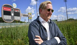 Music producer T Bone Burnett stands in the outfield of the old Sounds stadium where he has proposed an arts and music gathering as part of a mixed-use development at the site on  June 13, 2017, in Nashville, Tenn.     Burnett, who has lived off and on in Nashville for years and bought a home in West End three years ago, said he first noticed the site during his drives to the House of Blues Studios in Berry Hill. He said he set out to explore how to make the property active 365 days a year.  (Larry McCormack/The Tennessean via AP)