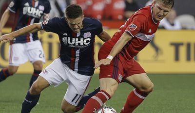 Chicago Fire midfielder Bastian Schweinsteiger (31), of Germany, pries the ball away from New England Revolution midfielder Kelyn Rowe (11) as Rowe attempted to acquire a bead on the goal during the first half of their MLS Soccer match, Saturday, June 17, 2017, in Foxborough, Mass. (AP Photo/Stephan Savoia)