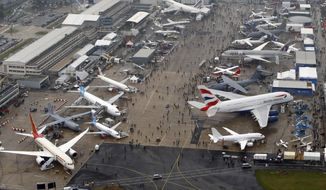 FILE - This Wednesday, June 19, 2013, file photo shows an aerial view of the 50th Paris Air Show at Le Bourget airport, north of Paris, France. While Airbus and Boeing will again hog the spotlight at the Paris Air Show with their battle for ever-larger slices of the lucrative pie in the sky, a lot of the really interesting stuff will be going on elsewhere at next week's massive biennial aviation and defense industry gathering. (AP Photo/Francois Mori, File)