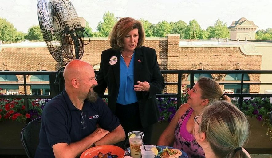 Republican Karen Handel campaigns at a restaurant in Johns Creek, Ga., Friday, June 16, 2017, ahead of runoff election to replace former Rep. Tom Price. Democrat Jon Ossoff is trying for an upset over Handel in the GOP-leaning 6th Congressional District that stretches across greater Atlanta's northern suburbs. (AP Photo/Alex Sanz) ** FILE **