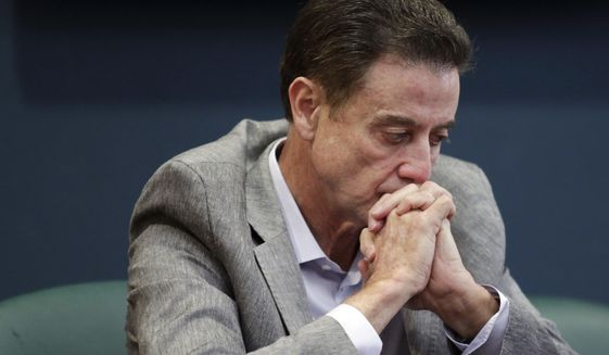Louisville basketball coach Rick Pitino listens during an NCAA college basketball news conference Thursday, June 15, 2017 in Louisville, Ky. The NCAA suspended Pitino on Thursday for five ACC games following sex scandal investigation. A former men's basketball staffer is alleged to have hired strippers to entertain players and recruits. (Alton Strupp/The Courier-Journal via AP)
