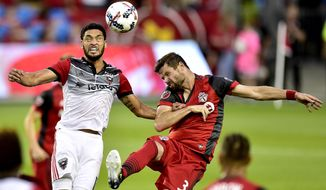 D.C. United midfielder Lamar Neagle (13) and Toronto FC defender Drew Moor (3) vie for control of the ball during first half MLS soccer action in Toronto, Saturday, June 17, 2017. (Frank Gunn/The Canadian Press via AP)