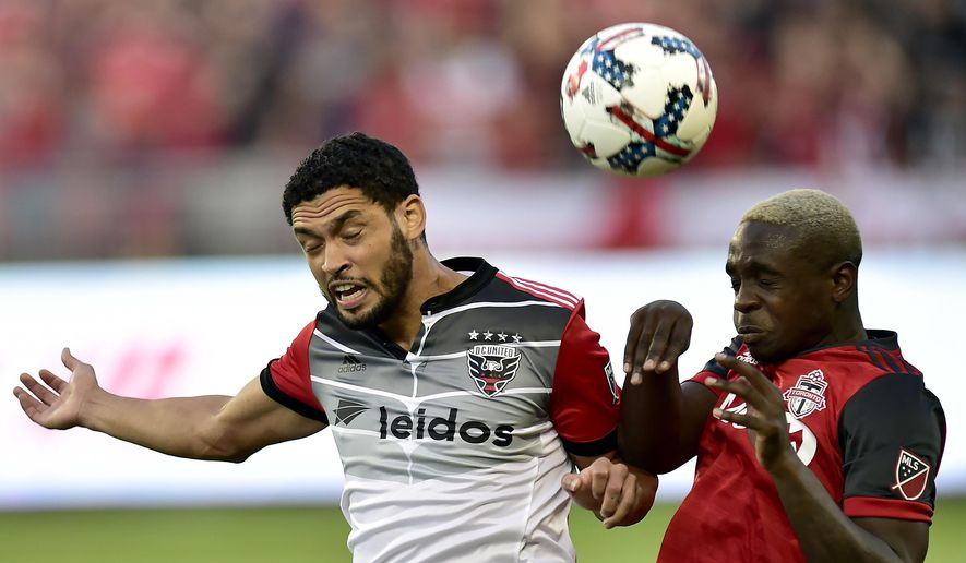 D.C. United midfielder Lamar Neagle (13) and Toronto FC defender Chris Mavinga (23) vie for control of the ball during first half MLS soccer action in Toronto, Saturday, June 17, 2017. (Frank Gunn/The Canadian Press via AP) **FILE**