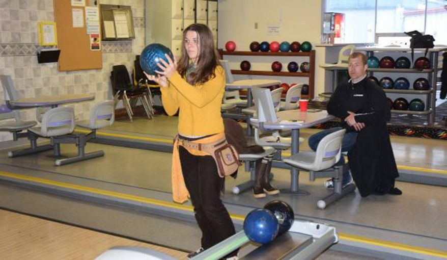 Rebecca Bells, left, and Juneau Police Department officer Krag Campbell bowl a game at Taku Lanes on June 10, 2017, in Juneau, Alaska, in preparation for a charity bowling match between the homeless and police officers. After coming to Juneau a month ago, Bells got started immediately in making the Street vs. the Beat homeless versus police bowling match happen. She's been impressed so far with how Juneau police department has taken to the idea and the respect with which she's been treated by law enforcement. (Kevin Gullufsen/The Juneau Empire via AP)