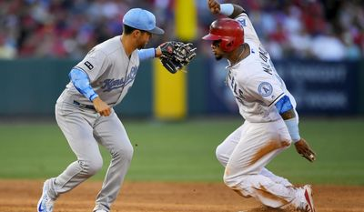 Los Angeles Angels' Martin Maldonado, right, is tagged out at second by Kansas City Royals second baseman Whit Merrifield while trying to steal during the sixth inning of a baseball game, Saturday, June 17, 2017, in Anaheim, Calif. (AP Photo/Mark J. Terrill)